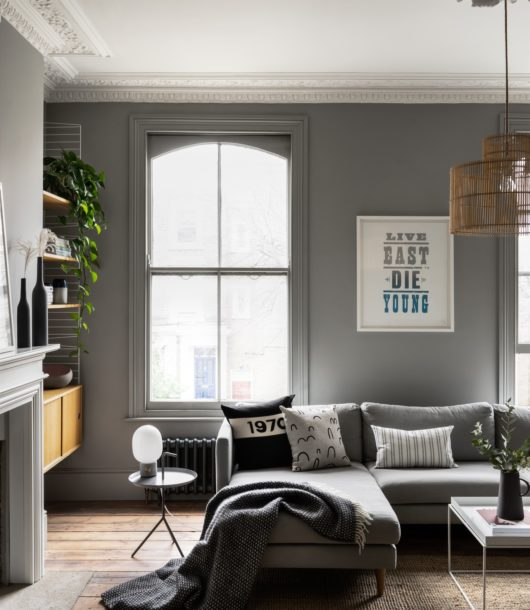 contemporary grey living room with modern quote