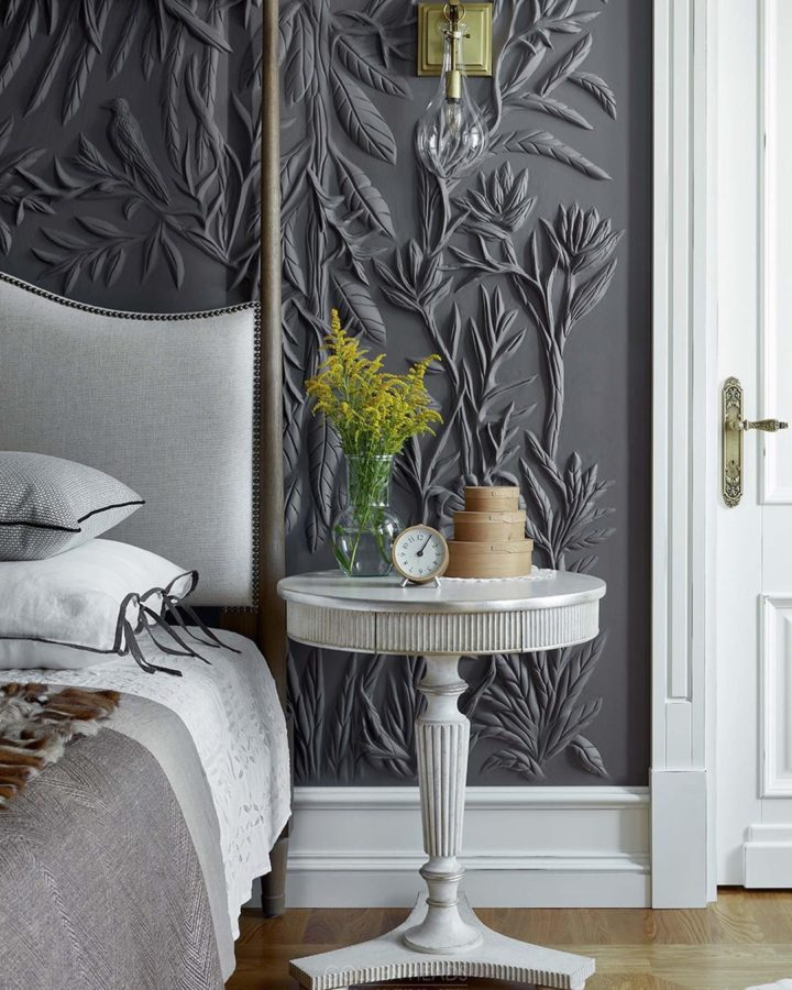 bedroom with gray canopy bed and 3D wallpaper