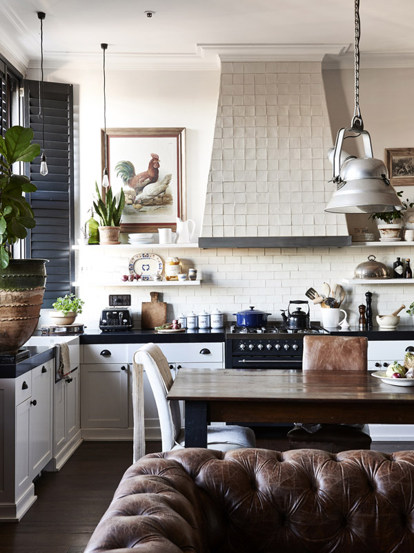 modern country white kitchen with white tiles on the splash back and ranger hood