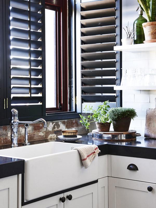 country farmhouse white kitchen with black smart stone counter top