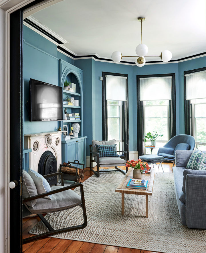 living room with blue walls and built-in shelves