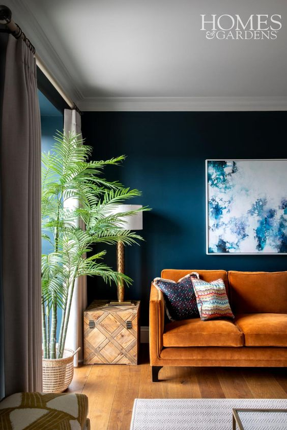 Tangerine and royal blue living room color scheme idea