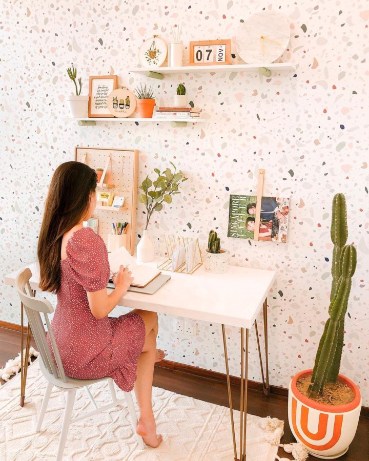 small stylish home office with white desk with gold legs