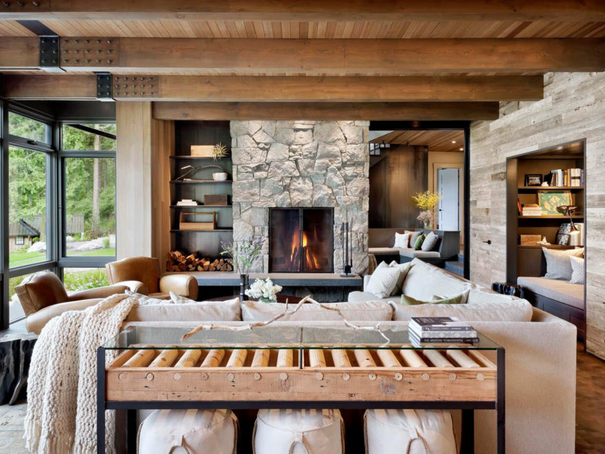 rustic ocean home large living room with stone fireplace and large windows