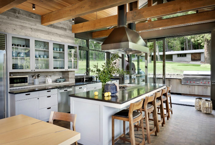large kitchen-with large island with stools and floor to ceiling windows