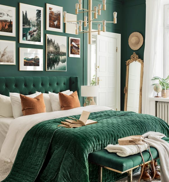 green bedroom with gold mirror