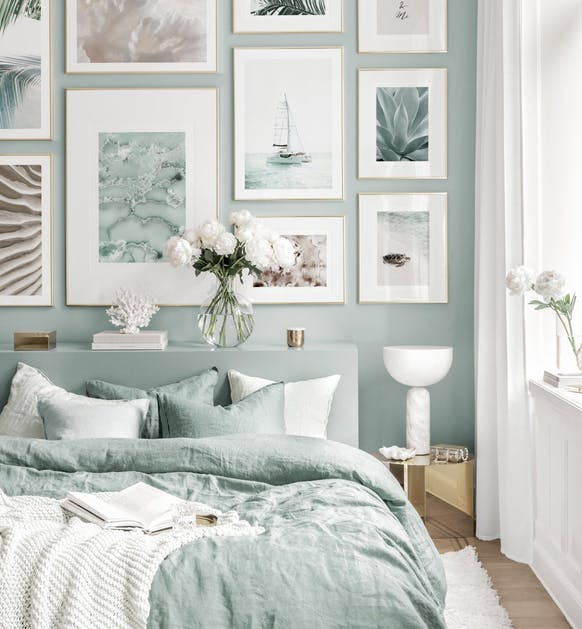 Light Green and White Bedroom with wall art gallery with water scenes features