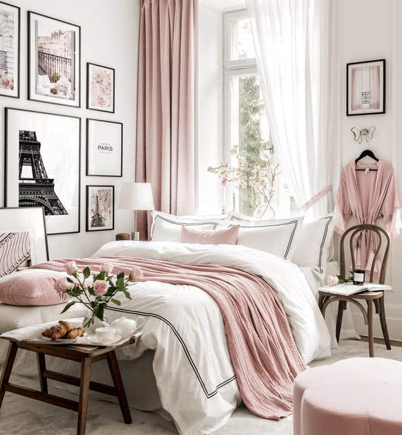 pink and white bedroom with bed in front of window