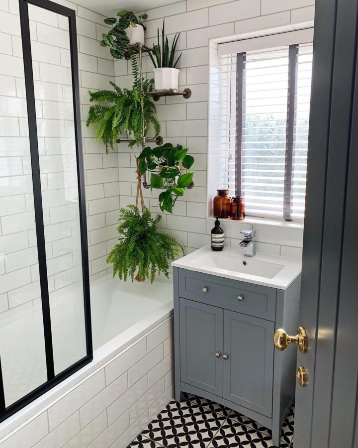 small bathroom with white Linear Patterns tiles grey vanity and hanging plants