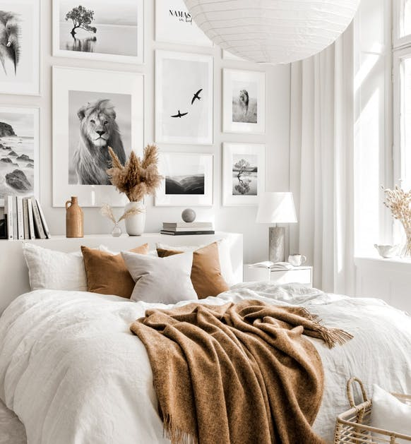 white bedroom with wall art gallery dried flowers and brown and brown decoration