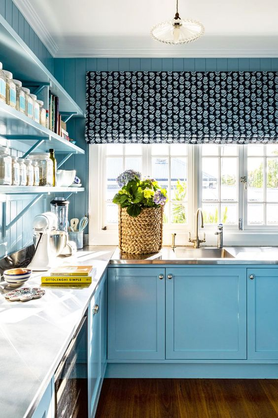 blue kitchen with tight navy and sky blue print curtain
