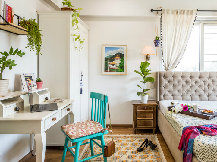 urban boho bedroom with turquoise chair