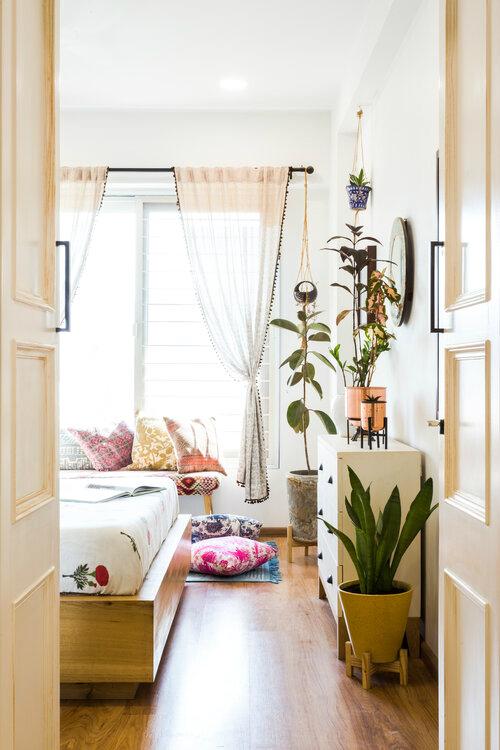 urban boho bedroom with boho white curtain