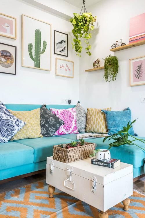 Urban Boho living room with turquoise sofa