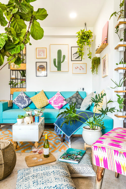 Urban Boho living room with turquoise sectional sofa