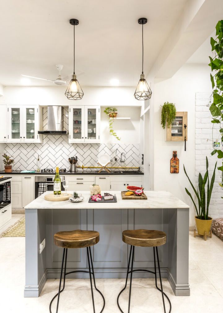 urban white kitchen with grey island and wood stools