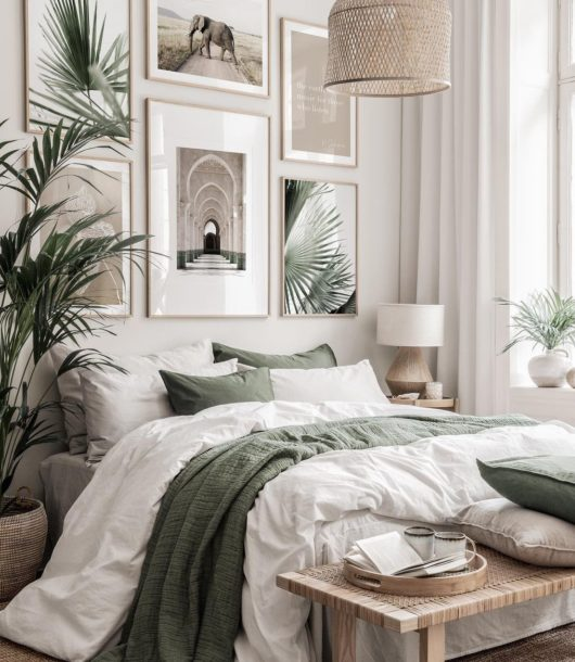 beige and green bedroom with coconut wall paint and poster wall gallery
