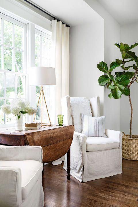 armchairs and table under window