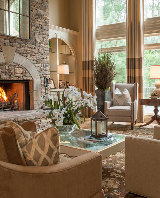 timeless formal cream and light brown living room with stone fireplace and high ceiling