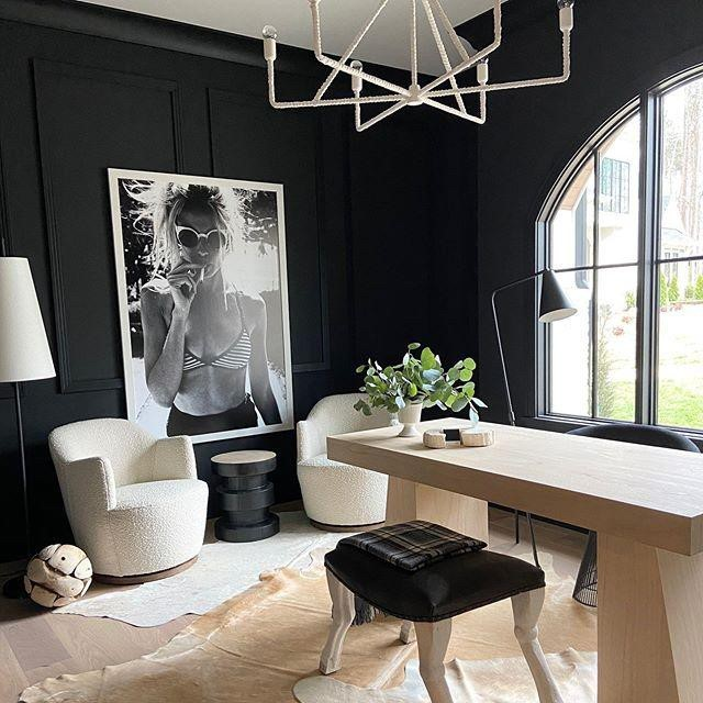 modern chic office with black walls and Vivienne Swivel chairs