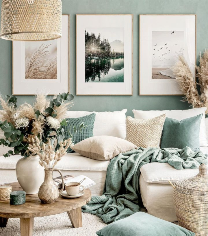 living room with cream contemporary sofa green wall and pillows and wall art gallery