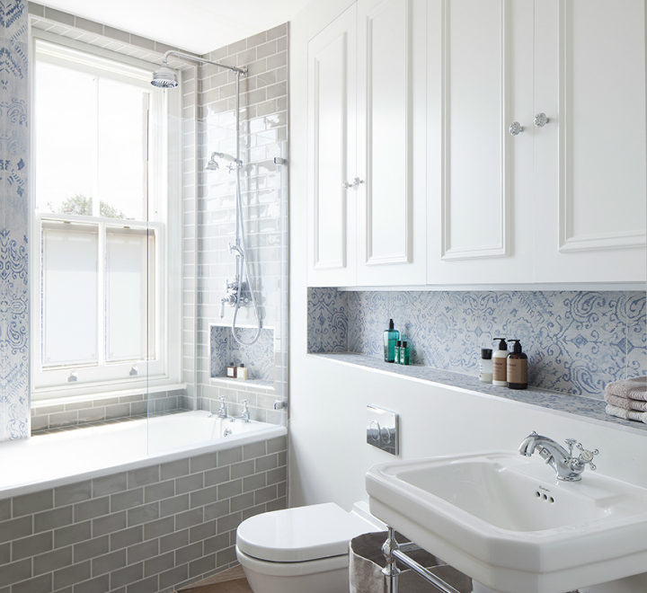 bathroom with grey metro tiles faux wood floor tile and Victorian print blue tile with a fabric-like texture.
