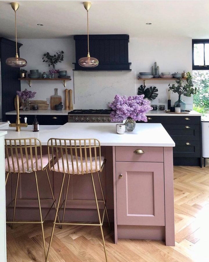 black kitchen with pink island