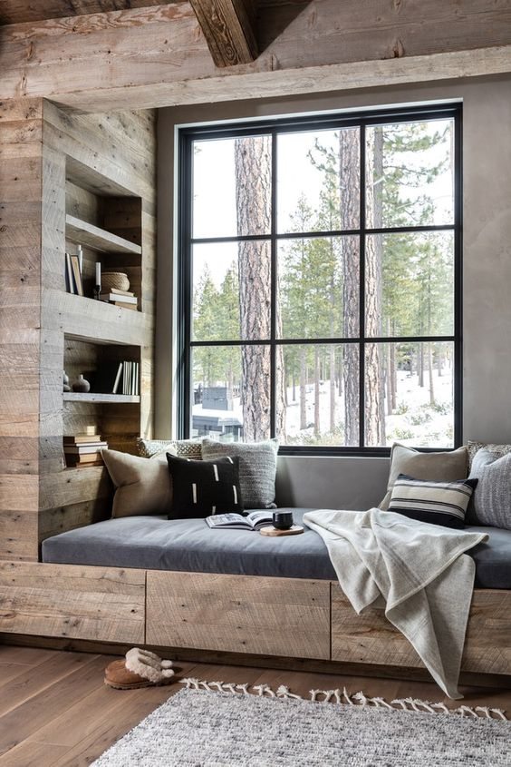 wood built in window reading nook with shelves