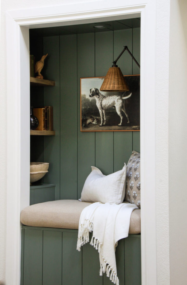 dark green reading nook with lazy arm lamp