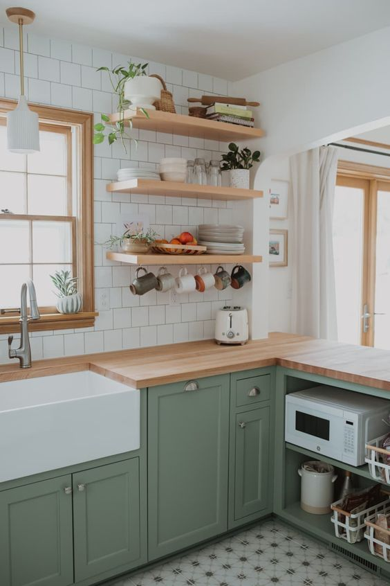 green kitchen with yellow pine wood countertop