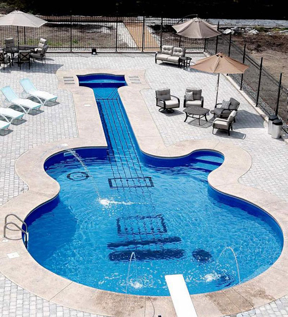 wimming pool shaped like a guitar by Aqua-Tech