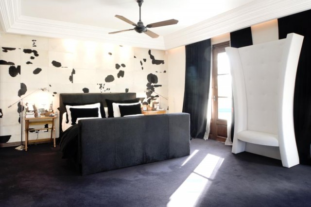 modern black and white bedroom with cow wall