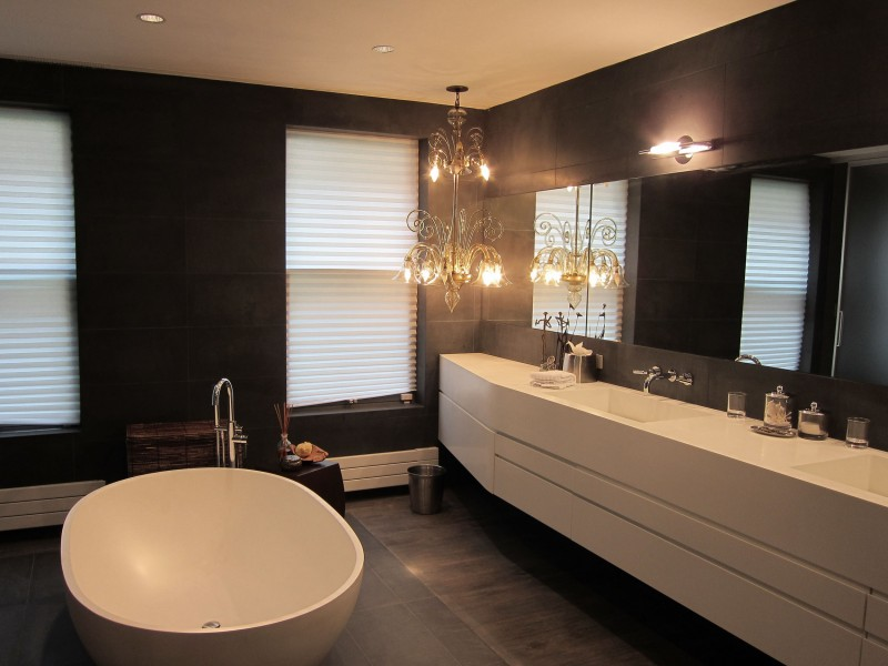 contemporary bathroom with chandelier