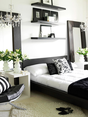 contemporary black and white bedroom with chandelier