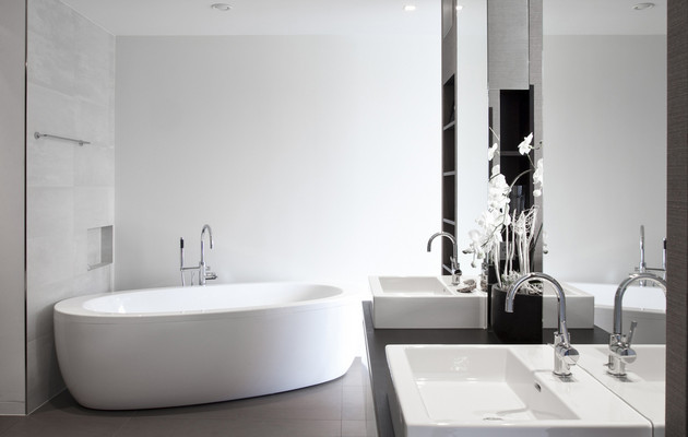modern white bathroom by neumann & partner